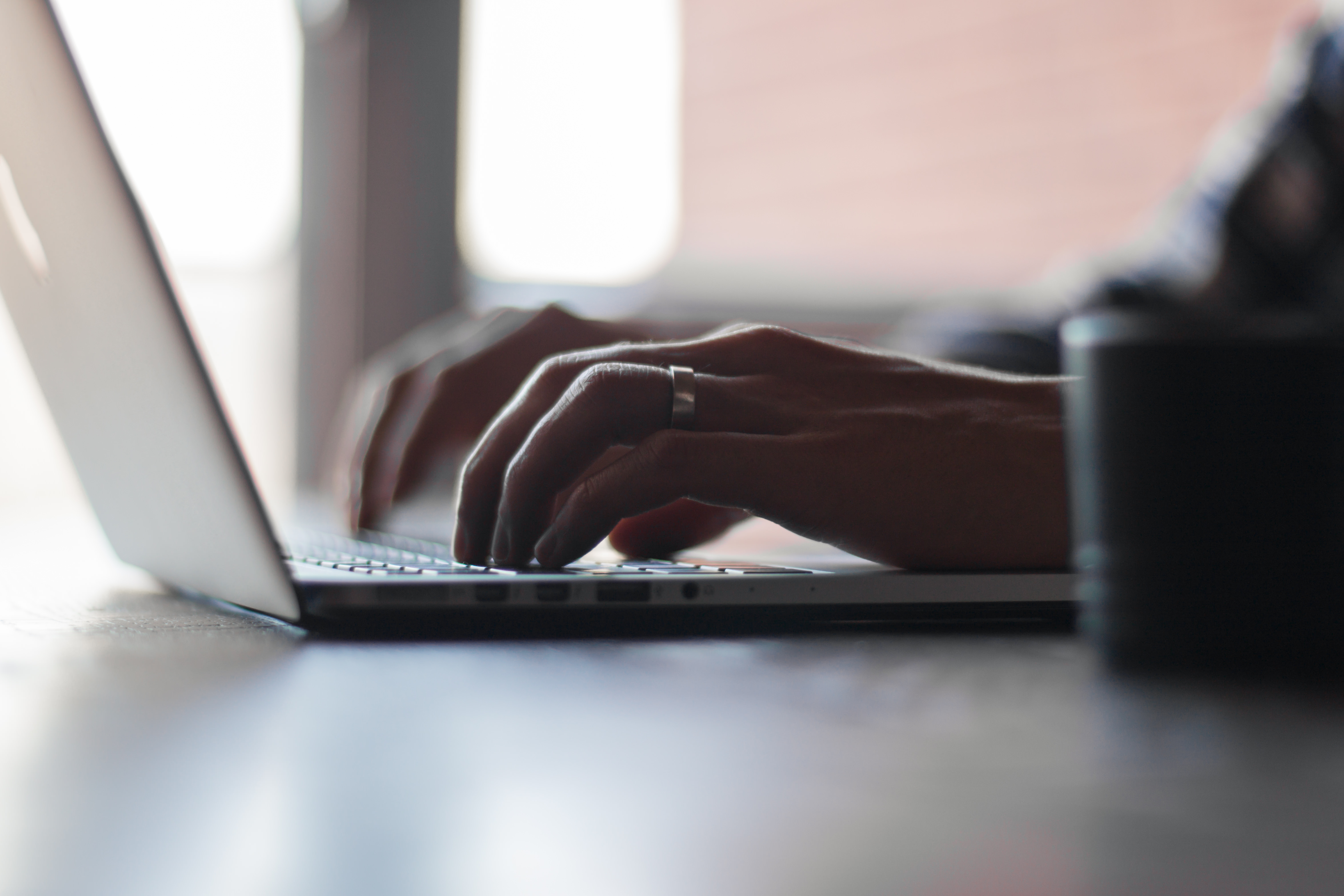 An image of a man starting a business blog on his laptop