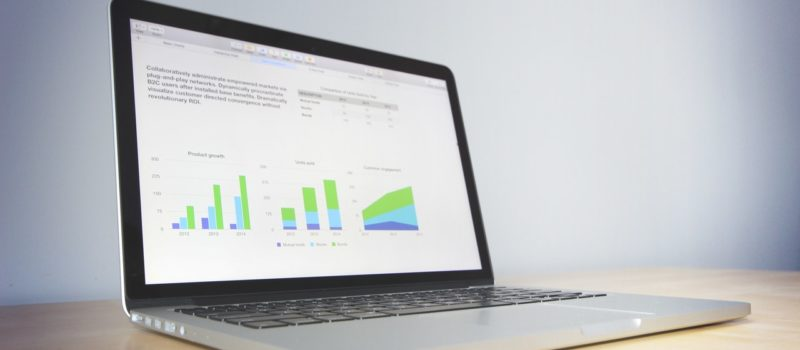 an image of a laptop displaying a variety of graphs and charts
