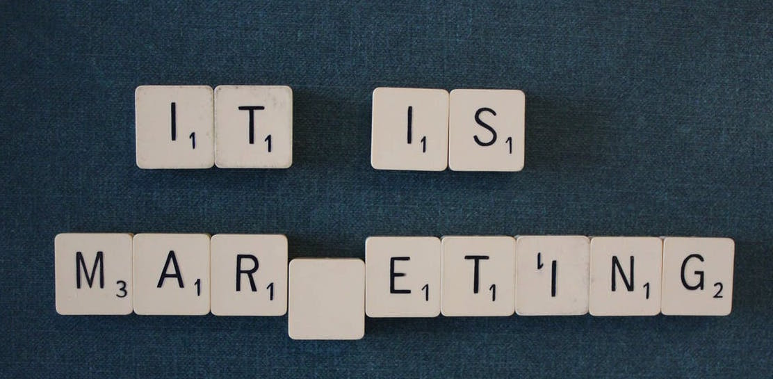 "an image of letter tiles spelling out ""it is marketing"""