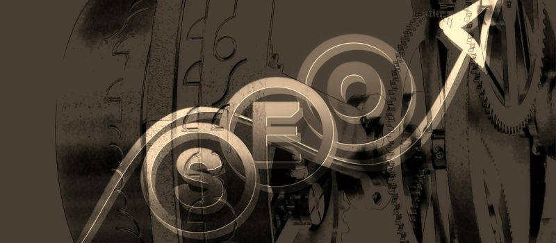 A visual image of the acronym SEO (Search Engine Optimisation) using cogs and gears and a black and gold design layout.